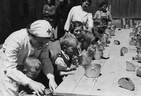 1945: Slovak Red Cross nurses feeding orphans during World War II.