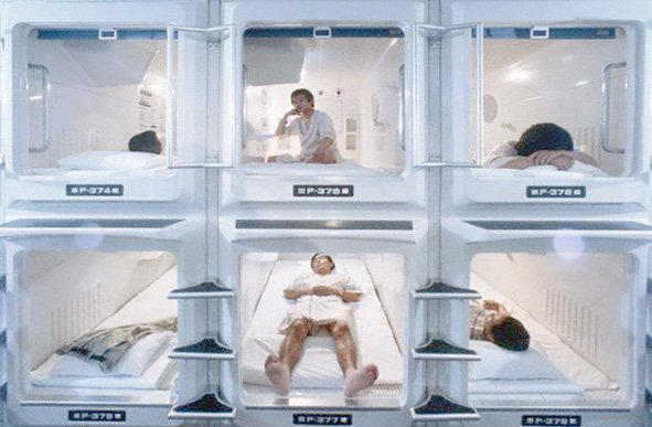 Businessmen in Capsule Hotel