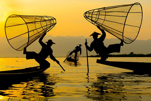 three fishmen on Inlelake in Myanmar