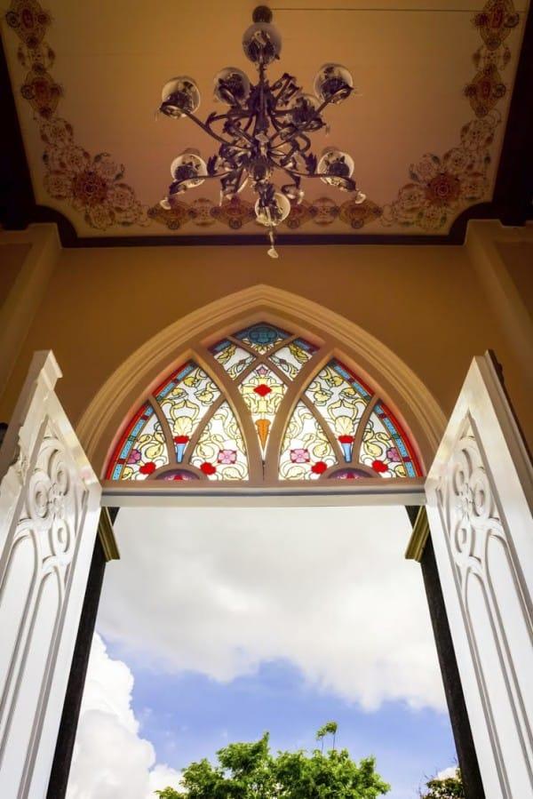 Open church door with hanging light