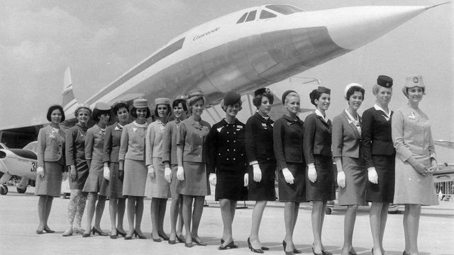 A line-up of some of the air stewardesses who attend to passengers on board the supersonic jet the 'Concorde', each one from a different airline. They are standing in front of a scale model of the aircraft. (Photo by Keystone/Hulton Archive/Getty Images)
