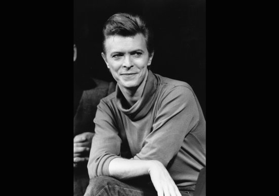 """FILE i In this Sept. 17, 1980, file photo, David Bowie listens during a news conference after a rehearsal at the Booth Theater in New York. Bowie was appearing in the Broadway production of """"The Elephant Man."""" Bowie, the innovative and iconic singer whose illustrious career lasted five decades, died Monday, Jan. 11, 2016, after battling cancer for 18 months. He was 69. (AP Photo/Marty Lederhandler, FIle)"""