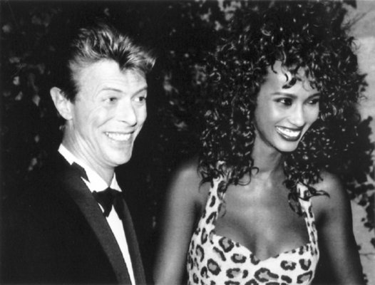 **FILE** David Bowie is seen with Iman smiling in 1991. The couple married in Lausanne on April 24, 1992. (AP Photo, file)