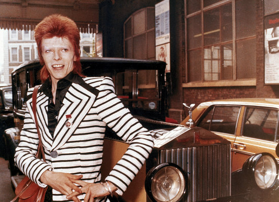 British rock singer, David Bowie, poses beside his Rolls Royce in May 1973. (AP Photo)