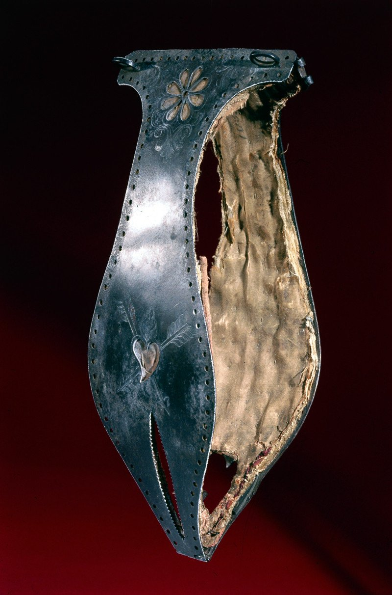 UNITED KINGDOM - NOVEMBER 22: Chastity belt decorated with a flower design and a heart pierced with arrows. Chastity belts originated in the 15th century. They were devices designed to prevent the female wearer from having sexual intercourse, and incorporated openings to facilitate urination and defecation. They were locked to prevent their removal. (Photo by SSPL/Getty Images)