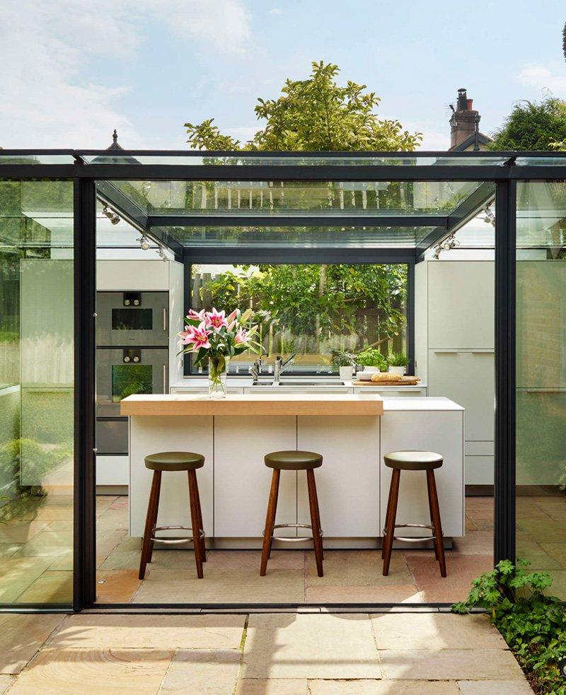 ampliación para la cocina con ayuda de paneles de cristal 8