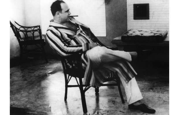 Picture dated 1930's of american gangster Al Capone, aka Scarface, in night-clothes. America's best known gangster Al Capone died from a heart attack at home 25 January 1947, after spending 8 years in jail. (Photo credit should read OFF/AFP/Getty Images)