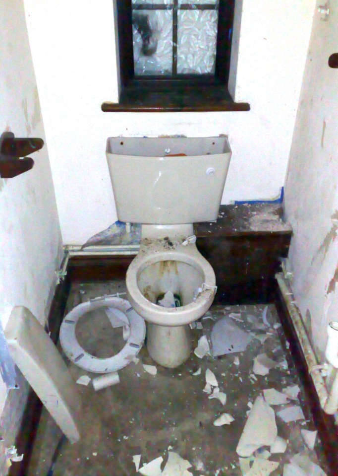 The downstairs toilet in the abandoned and derelict mansion of £9.4m lottery lout Michael Carroll. The house set in vast grounds is in a terrible state with every window smashed and every room trashed with litter left in great piles.