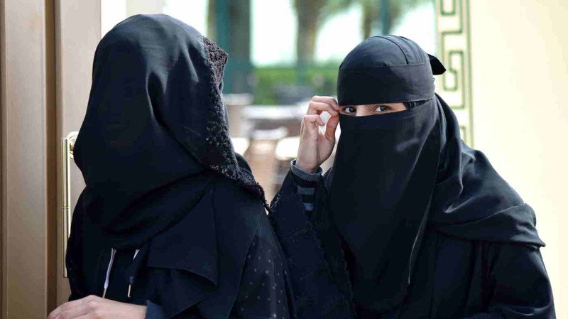Women walk out of a polling station after casting their votes for municipal elections in Riyadh, Saudi Arabia, on Saturday.