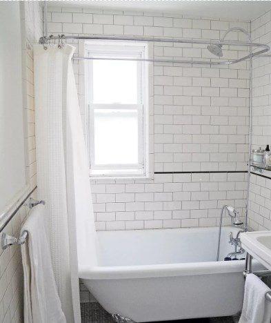 baño blanco con bañera