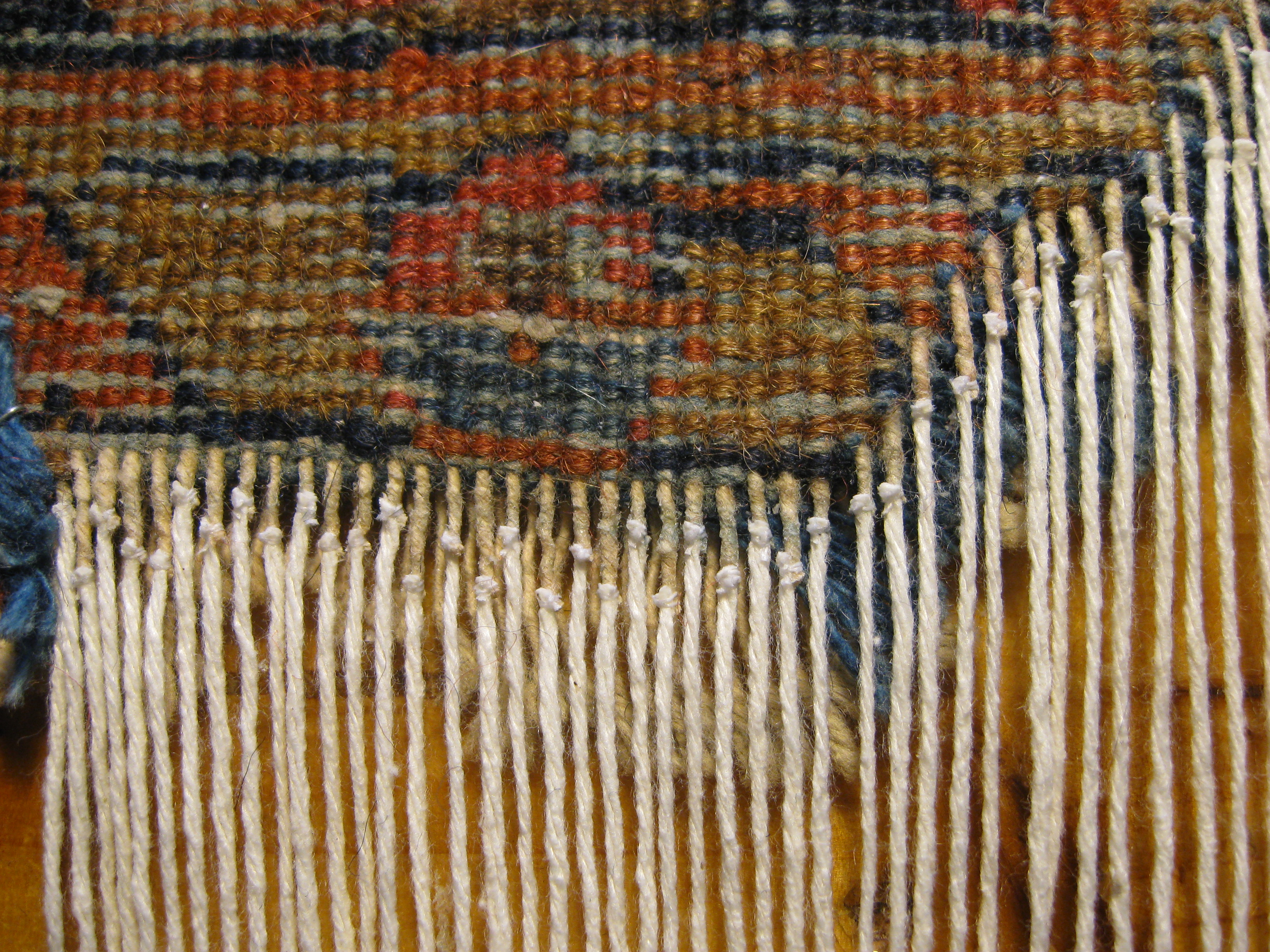 reparar_alfombra