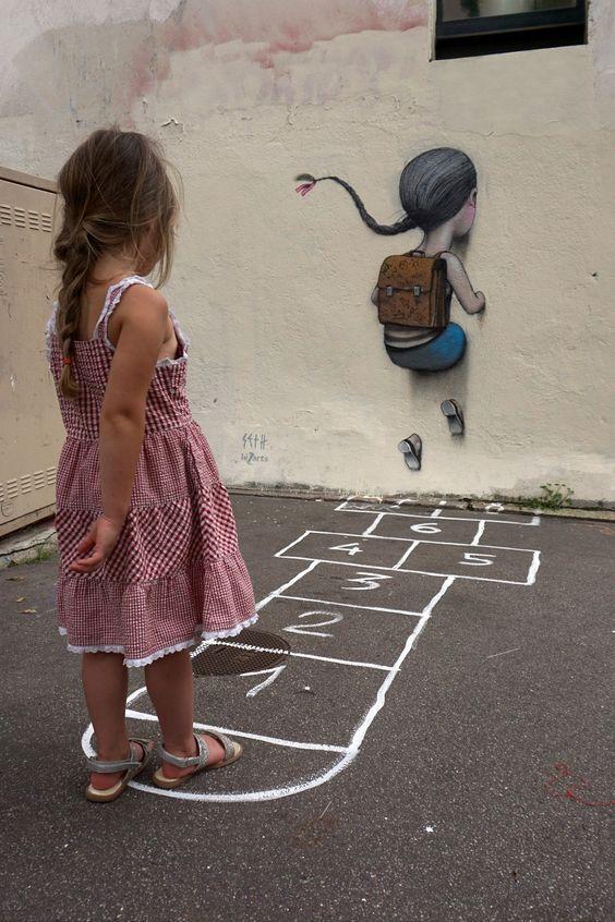 graffiti niña saltando