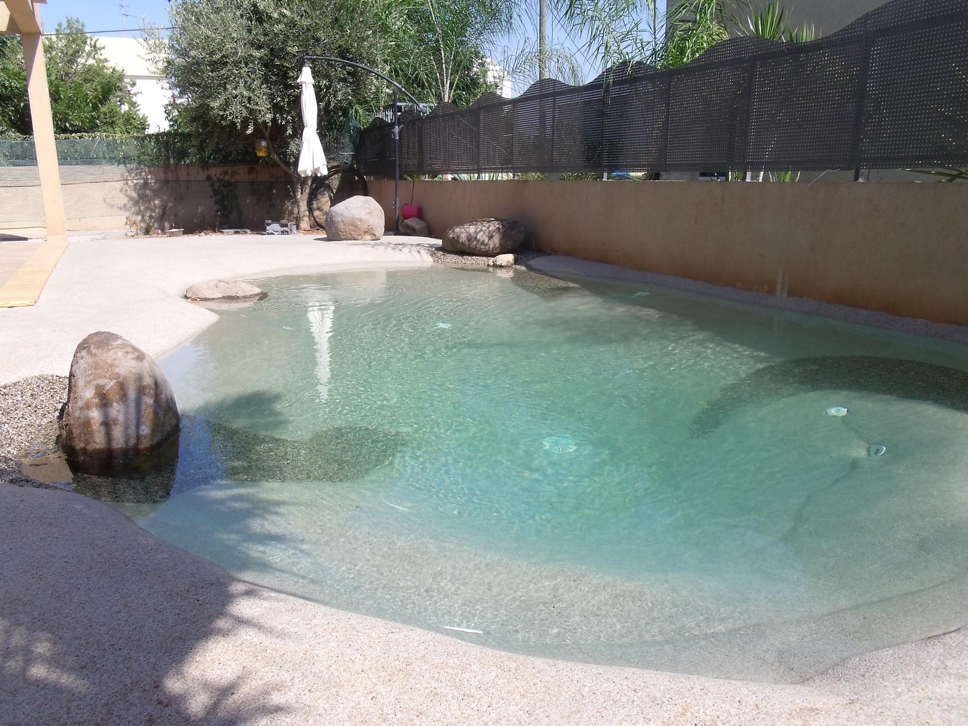 piscinas de arena de playa en jardín