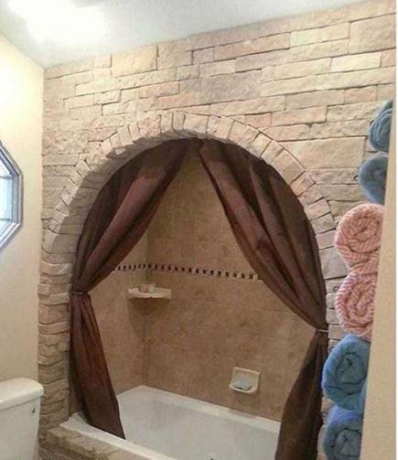 bañera con arco de piedra diseños de interiores terribles
