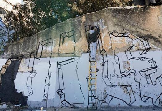 muro con graffitero