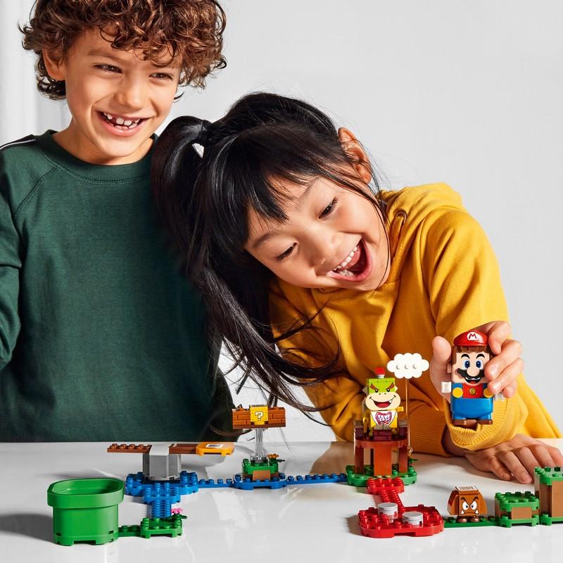 niños jugando lego super mario