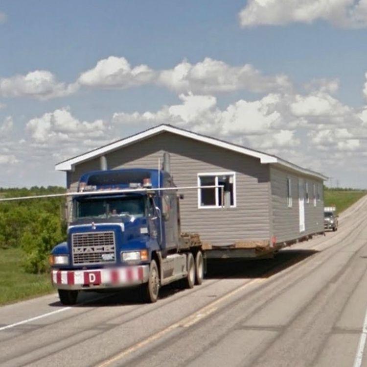 trailer transporta casa